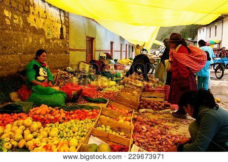 La Union, Peru - 05 February 2012: Peruvian Ethnic Woman In National Clothes Selling Agricultural Pr