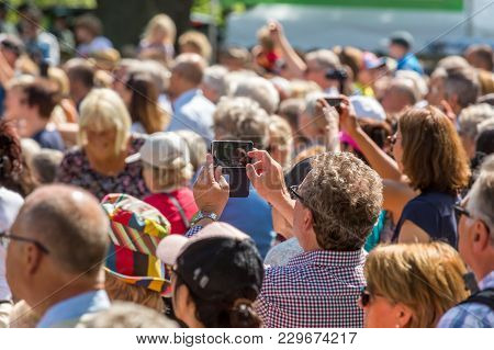 Jakobsberg, Sweden - June 6, 2017:  View From Behind Of Many People Together Outdoors. A Senior Woma