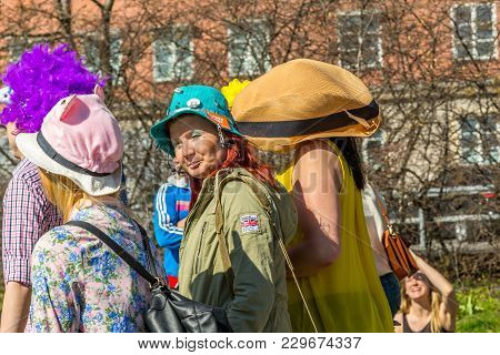 Stockholm, Sweden - May 1, 2017: Profile View Of A Few Woman With Decorative Hats Walking In A Publi