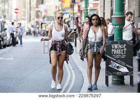 London, England - July 12, 2016 Hipster Gilrs Dressed In Cool Londoner Style Walking In Brick Lane,