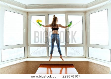 Slender Woman Washes Windows, She Is Cleaning In The Apartment.