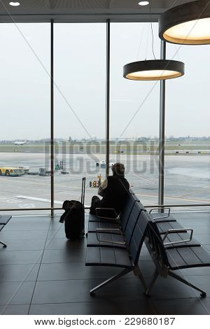Passenger Traveler Woman In Airport Waiting For Air Travel