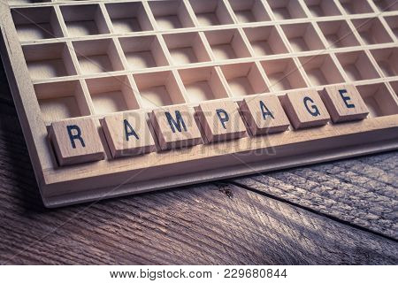 Closeup Of The Word Rampage Formed By Wooden Blocks In A Type Case