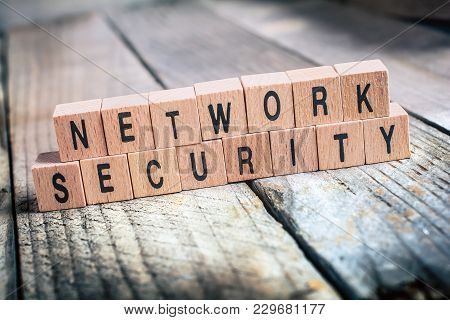 Macro Of The Words Network Security Formed By Wooden Blocks On A Wooden Floor