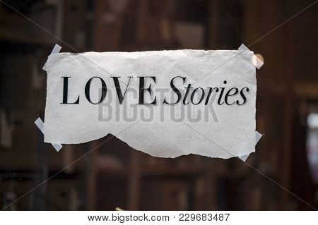 The Inscription Love Stories Hanging On The Wall.