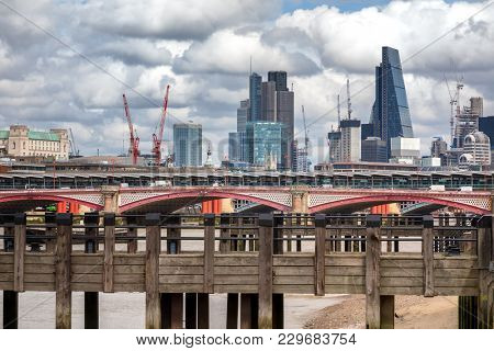 Wharf on the River Thames, with Blackfriars Bridge, and the City of London beyond.