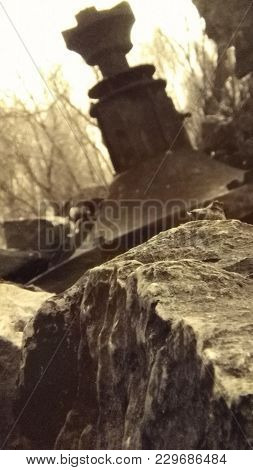 Off Kilter Metal Object And Rocks Outside