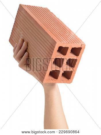 Close-up Of Hand Holding Brick Over White Background