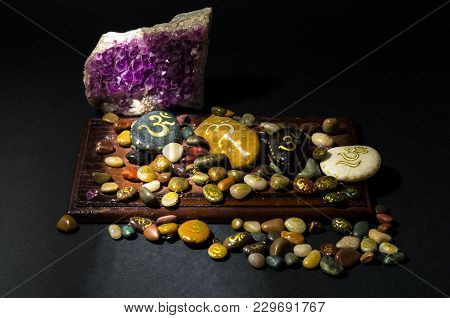 Amethyst Crystal And Colorful Stones Painted With Om Symbol