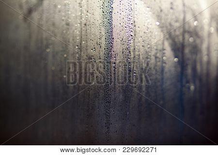 Flowing Down Water Drops On Window Glass