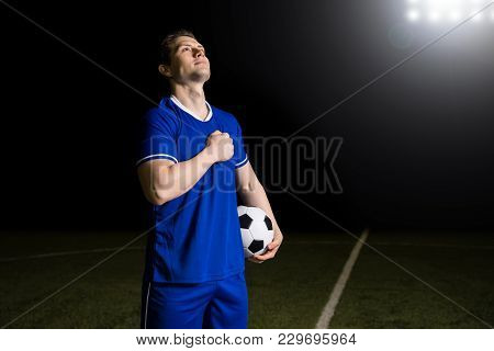 Young Soccer Player In Blue Jersey Feeling Proud After Winning The Soccer World Cup Competition