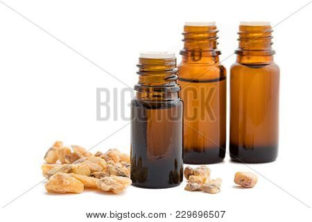 A Bottle Of Styrax Benzoin Essential Oil With Styrax Benzoin Resin And Other Bottles On A White Back