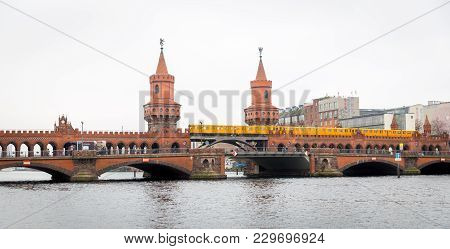 U-bahn Train Passing Over Oberbaum Bridge In Berlin City, Germany