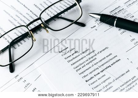 Business Composition. Financial Analysis - Income Statement, Pen And Glass
