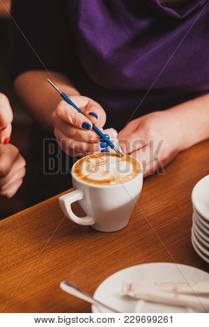 Barista Making A Cup Of Latte Art Coffee With Special Metal Device - Latte-art Pen Tool