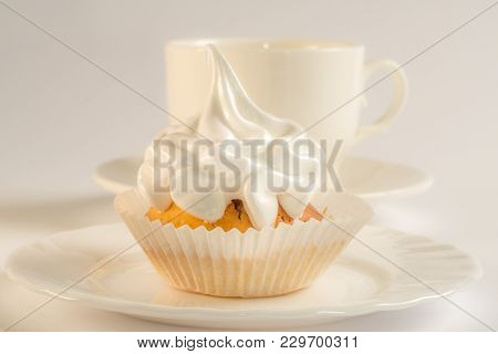 Kapteyka And A Cup Of Tea. Cupcake With Icing. Dessert On A Saucer And A Cup Of Coffee. Baking With