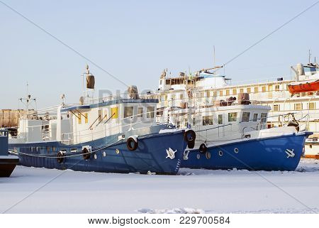 Ruver Tugboats And Passenger Vessel During Wintering In The Backwaters