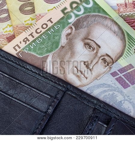 Banknote Of Five Hundred Ukrainian Hryvnia In A Black Leather Purse. Square. Close-up.