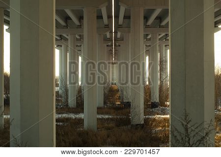 View From Below On Concrete Supports Of An Automobile Bridge Across A Floodplain River Valley In Aut