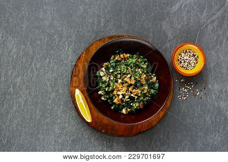Bowl Of Detox Healthy Salad Flat Lay. Fresh Raw Kale Salad With Quinoa, Feta Cheese And Walnut Over