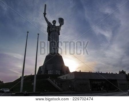 Ukraine, Kiev - September 17, 2017: Monument Of Motherland Mother On Sunset Background. Evening, Dar