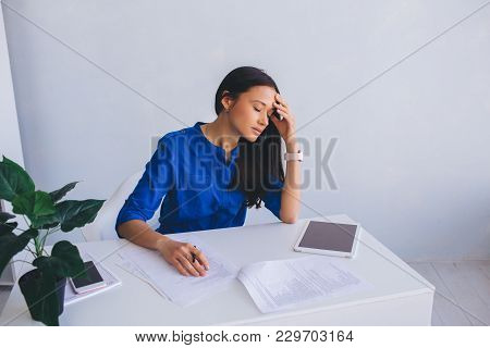 Attractive Young Woman Feeling Tired, Leaning Her Head On Hand And Closed Eyes. Failure And Fatigue