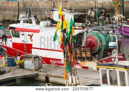 Sables D Olonne, France - March 16, 2016 : Closeup Of Flags Hung On Floats On Fishing Boats Near Sta