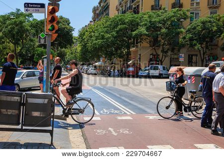 Barcelona, Spain - June 21, 2017 : Cyclist Crossing A Pedestrian Crossing On A Summer Day
