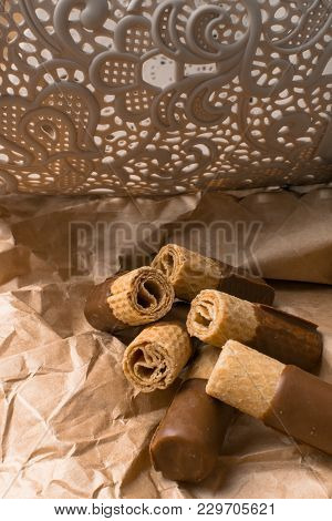 Sweet Wafer With Dark Chocolate On The Paper Bag And Beautiful Ornament Back