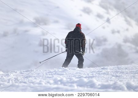 Skier In High Mountains . In The Park In Nature