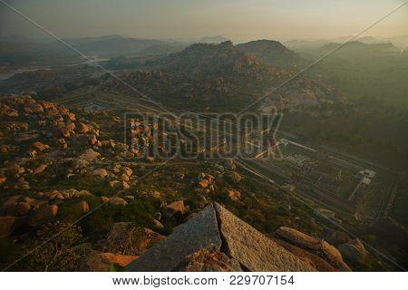 Hampi, India - 5 Dec. 2014:  Ruins of Vijayanagara capital of the Vijayanagara Empire. View from mountain Matangi on sunrise Hampi Karnataka India