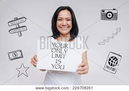 Encouraging Words. Enthusiastic Positive Young Woman Feeling Happy And Smiling While Standing Agains