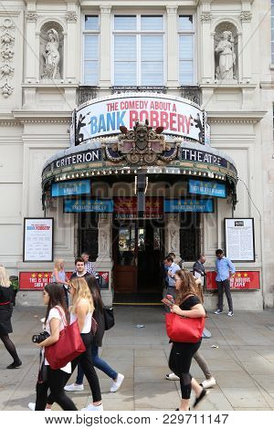 London, Uk - July 9, 2016: People Walk By Criterion Theatre In West End, London, Uk. West End Theatr