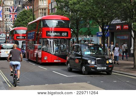 London, Uk - July 7, 2016: People Ride New Routemaster Buses In Oxford Street, London. The Hybrid Di