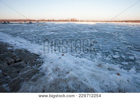 Close Up Of Ice Floes On The Frozen Danube River, Expanded Over The Shore In The Winter Day