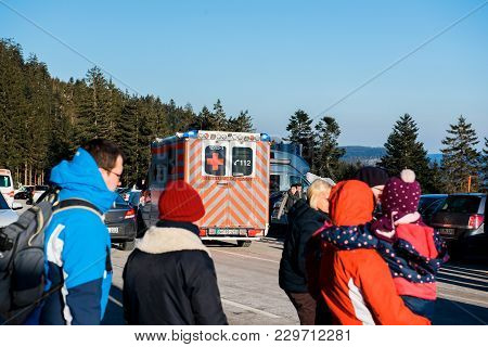 Seebach Mummelsee, Feb 25, 2018: Deutsches Rotes Kreuz Ambulance In German Parking With People Cross