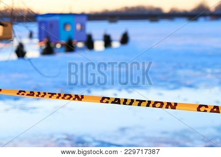 Caution Sign Of Thin Ice In The Fishing Village Installed On The Lake At Risk Of Drowning. Warning O