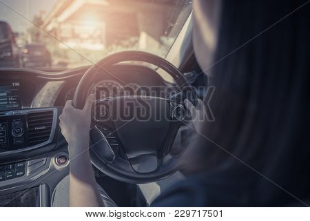 Young Women Driving A Car