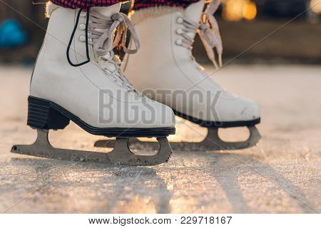 Close-up Of Woman Skating On Ice. Close-up Of Skates And Ice. Side View.