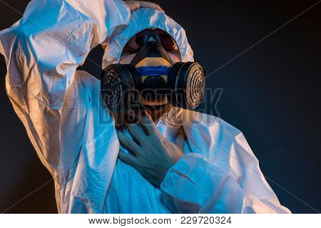 virus infection concept. Man in protective suit and antigas mask with glasses. Ebola, toxic gases, biological warfare, infections and diseases