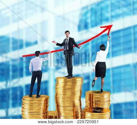 Business Team Draws Red Growing Arrow Of Company Statistics Over The Piles Of Money