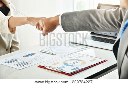 Businessman And Businesswoman Making A Fist Bump Together After Good Deal. Business Success And Team