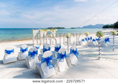 The Decoration Of Beach Wedding Venue In White And Blue Theme, The Panoramic 360 Ocean View In The B