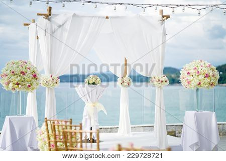 The Wedding Venue On The Hill With Panoramic Ocean View, The Arch In White Decorated With Flowers, F