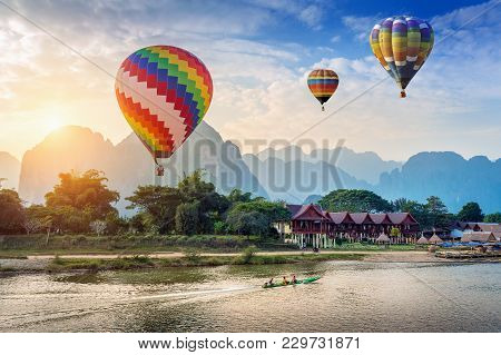 Hot Air Balloon Over Nam Song River At Sunset In Vang Vieng, Laos.