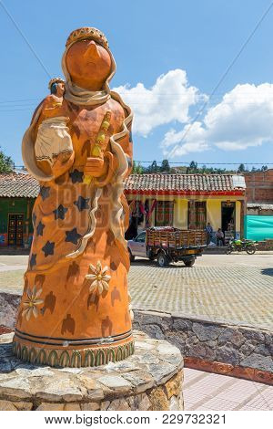 February 2018 Raquira This Terracotta Statue Representing  A Woman With Child, Is Located In The Mai