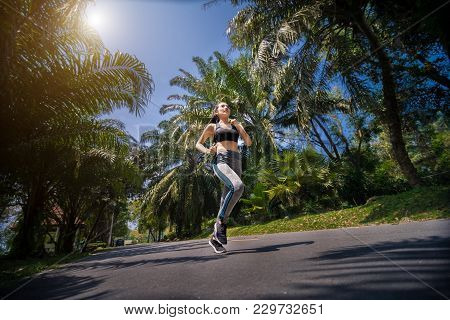 Pretty Sport Woman Jogging In The Park, Running Outdoors In Nature