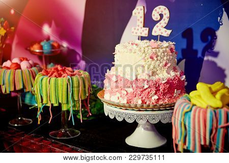 Girlish Birthday Party Food - Colorful Round Cake Decorated With Macaroons, Candies And Candles, Mar
