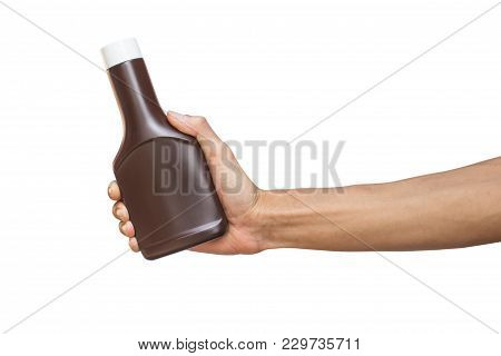 Man Hand Holding Brown Bottle Isolated On White Background With Clipping Path.