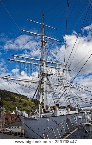 Masts Of Sailing Ship With Blue Sky And Clouds On The Background. Sunny Day.